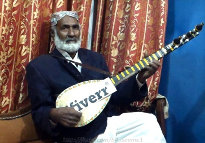 display Your Brand On a Tambura Desi Guitar In a Live Melodious Music Playing Session