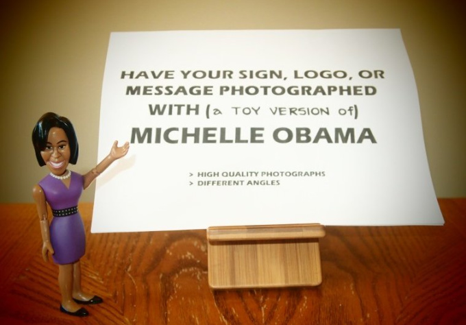 photograph your message with a toy version of Michelle Obama