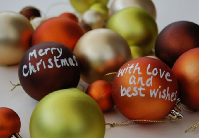 write your Christmas message or greeting on coloured baubles