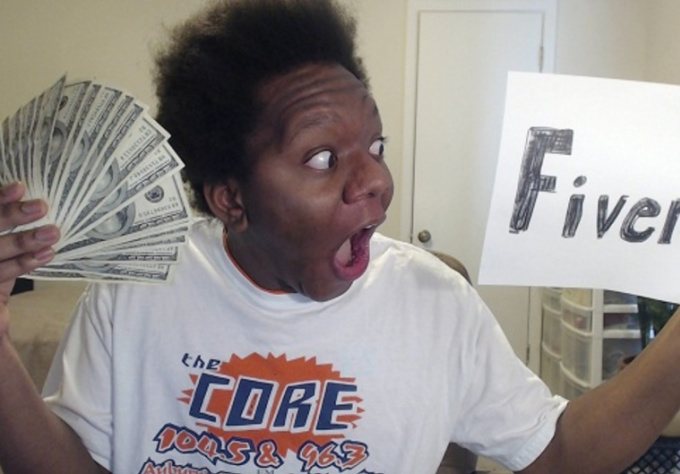hold your sign and take 5 CRAZY pictures with a wad of cash
