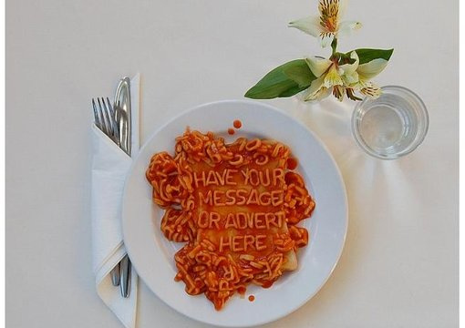 write the short message of your choice in alphabetti spaghetti on toast or plate