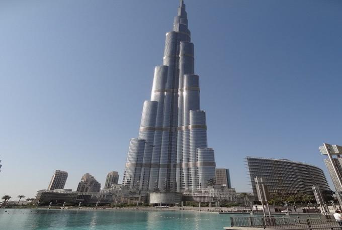 Hold Your Sign In Front Of Burj Al Arab Or Burj Kha