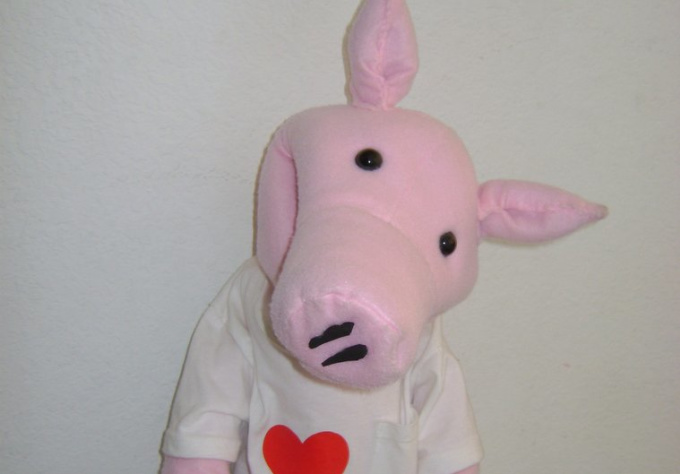 as a dancing pig puppet Promote and send greetings