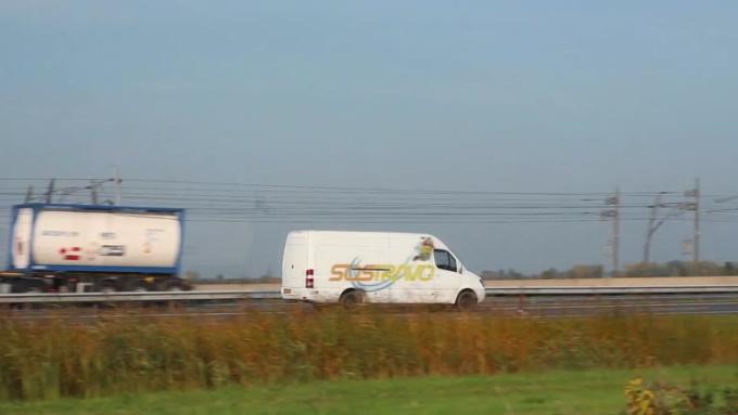 van on highway SLOWER