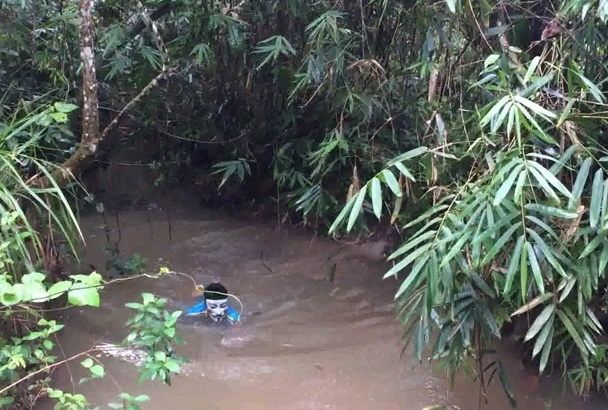 make a video of funny mask boy swim in natural water stream