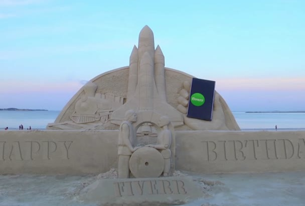 do greeting or invitation video on a sand castle